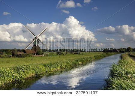 De Wingerdse Molen Near Bleskensgraaf In The Dutch Region Alblasserwaard With The Diesel Pumping Sta