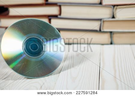Book With Compact Disc Over White Background E Book Or Digital Storage Concept