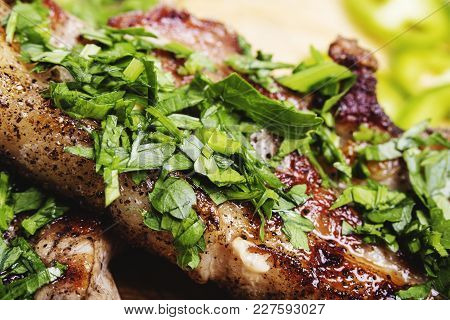 Cooked Fried Pork Meat With Parsley Herb Leaves Garnish