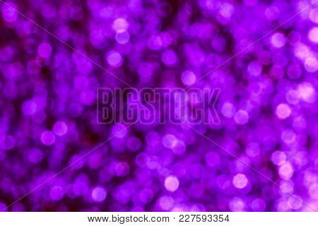 Colorful Bokeh. The Creative Image Of The Bright Holiday Lights In Blue And Purple Tones, Blurred Ba