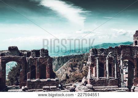 Ruins of ancient theatre of Taormina on sunny day, Messina, Italy