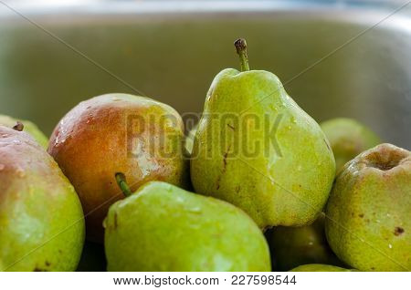 Pear Texture: Lots Of Pears Collected In A Bowl. Pear Storage.