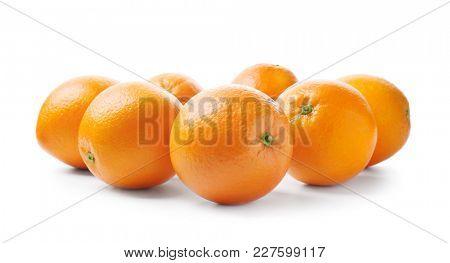 Juicy ripe oranges on white background