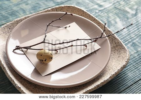 Beautiful festive Easter table setting with blank card, closeup