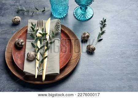 Beautiful festive Easter table setting with quail eggs