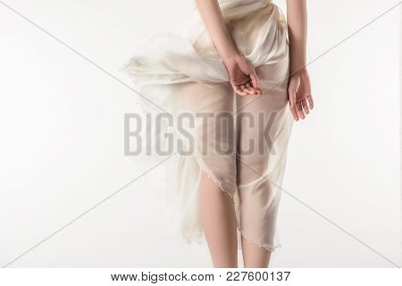 Back View Of Nude Girl In Waving Chiffon Dress, Isolated On White