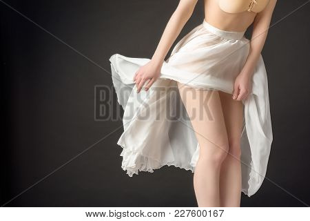 Cropped View Of Sensual Girl Posing In Elegant Chiffon Skirt, Isolated On Grey