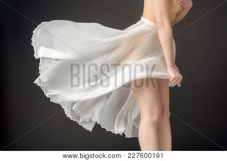 Cropped View Of Elegant Girl In Waving Chiffon Skirt, Isolated On Grey
