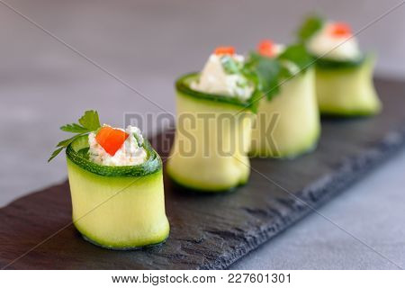 Rolls Of Zucchini Stuffed With Cheese And Chives And Red Paprika.