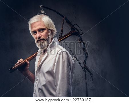 Portrait Of An Old Man With A Gray Beard.