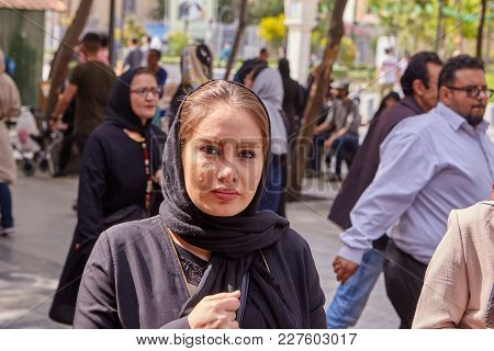 Tehran, Iran - April 29, 2017: The Face Of A Young Muslim Woman Walking In A Crowd Of City Residents