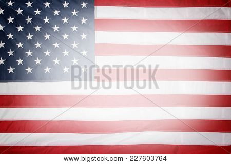 Closeup of stars and stripes American flag. Bright central area