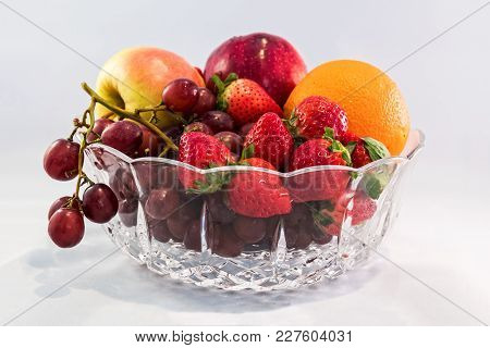 A Fresh Bowl Of Fruit With Neutral White Background.
