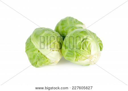 Uncooked Brussel Sprouts On A White Background