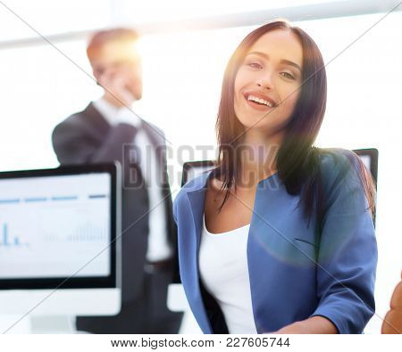 Portrait of beautiful cheerful smiling business woman