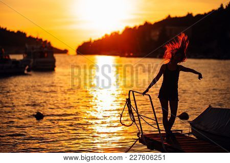 Sensual carefree summer woman enjoying vacation.Seaside stress less lifestyle.Fit traveler enjoying