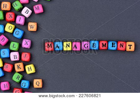 Management Word On Blue Background Close Up