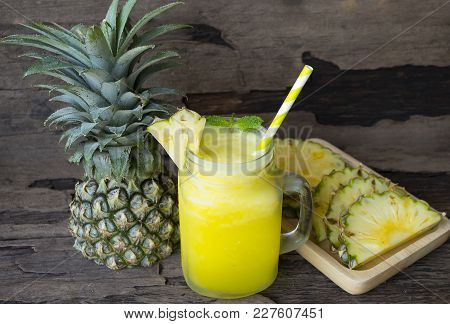 Pineapple Smoothies Juice Yogurt And Pineapple Fruit For Breakfast In The Morning On A Wooden Floor.