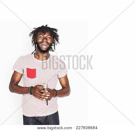 Young Handsome African American Boy Singing Emotional With Microphone Isolated On White Background,