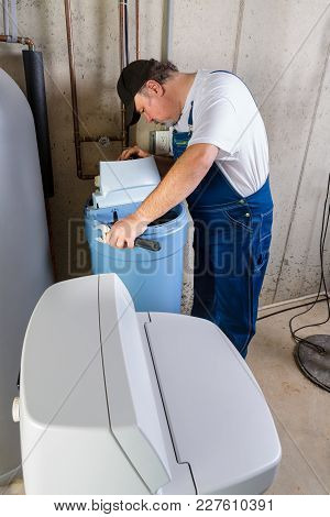 Workman Installing A Domestic Water Softener Troubleshooting Installation Problems In A Basement Uti