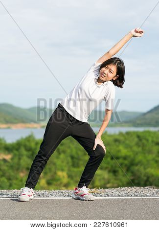 Woman Doing Exercising And Warm Up Outdoor