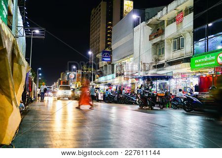Chiang Mai Thailand - February 3 2018;  Blurred Image Of Person In Orange Crossing City Street On Da