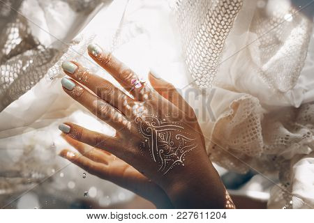 Close Up Of Woman Hand With Manicure Touching White Bribal Fabric