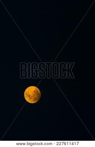 Super Moon Vertical Isolated In Dark Night Sky