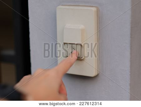 Focus On Finger Pressed On The Doorbell.