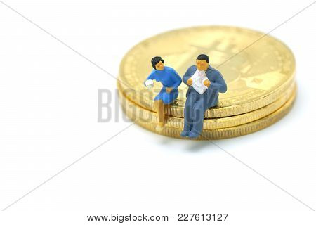 Miniature People Businessmen Talk, Sip Coffee. Sitting On Investment Analysis Gold Bit Coin . Commun