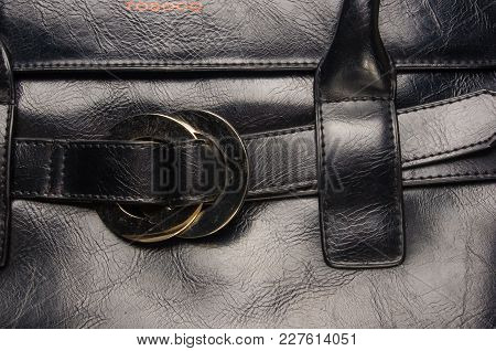 Closeup Of Buckles, Clasps, Zippers, Pockets, Fasteners, Fittings And Seams On Black Leather Hand Ba