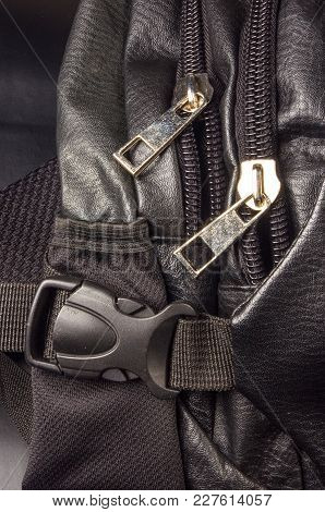 Closeup Of Buckles, Clasps, Zippers, Pockets, Fasteners, Fittings And Seams On Black Leather Backpac