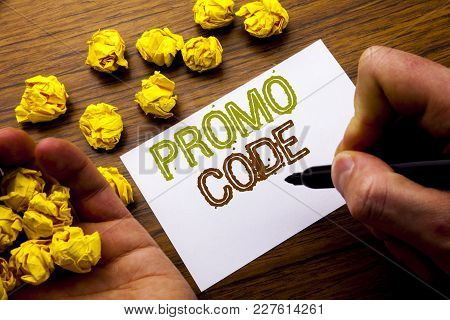 Word, Writing Promo Code. Concept For Promotion For Online Business Written On Notebook Note Paper O