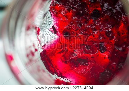 Bright Translucent Red Currant Jam In A Glass Jar, Close-up, Macro Photo