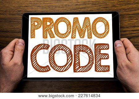 Hand Writing Text Caption Promo Code. Business Concept For Promotion For Online Business Written Tab