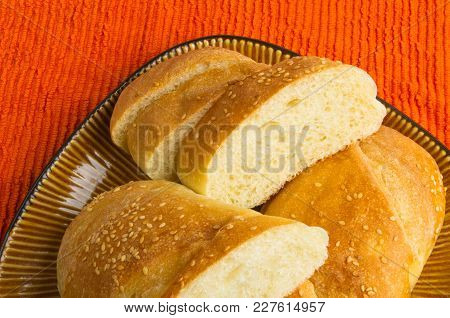 Sliced Whole Wheat Breads On A Brown Plate