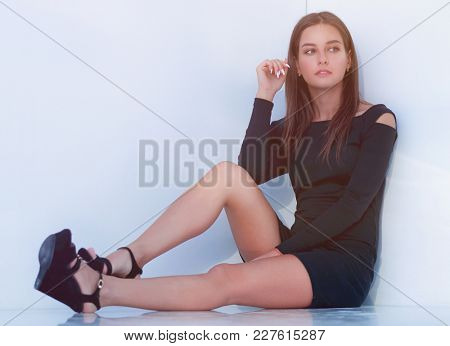 sad young woman sitting on the floor