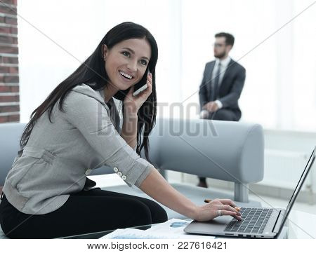 Woman assistant at her workplace.