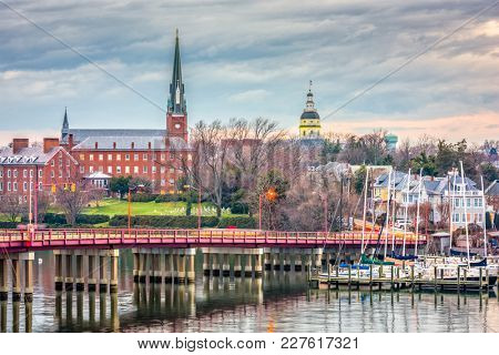 Annapolis, Maryland, USA State House and St. Mary's Church viewed over Annapolis Harbor and Eastport Bridge.