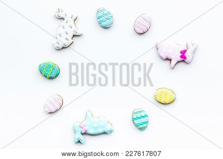 Sweets, Pastry For Easter Table. Easter Eggs And Easter Bunny Concept. White Background Top View.