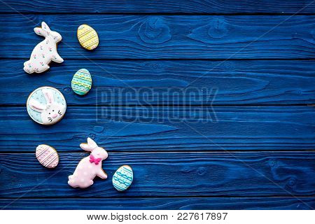 Easter Bunny And Easter Eggs Cookies. Easter Symbols And Traditions. Blue Wooden Background Top View