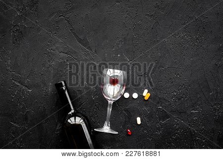 Alocohol Abuse And Alcoholism Treatment Concept. Glasses, Bottles And Medcine Pills On Black Backgro