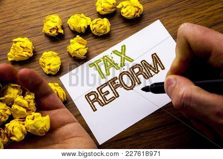 Word, Writing Tax Reform. Concept For Government Change In Taxes Written On Notebook Note Paper On W