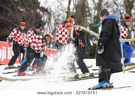 Zagreb, Croatia - January 4,2018 : Ski Staff Gulf The Water With The Fire Hose On The Ski Trail Befo