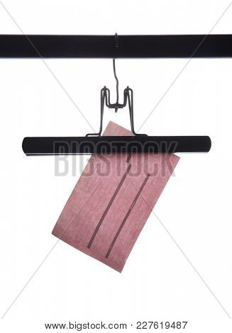Pink receipt dangling from a black hanger against a white background.