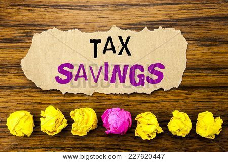 Handwriting Text   Tex Savings . Concept For Tax Savings Extra Money Refund Written On Sticky Paper