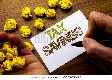 Word, Writing Tex Savings . Concept For Tax Savings Extra Money Refund Written On Notebook Note Pape
