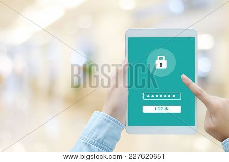 Hand Using Tablet With Password Login On Screen, Cyber Security Concept