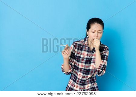 Attractive Young Girl Coughing When She Smoking