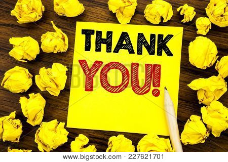 Writing Text Showing Thank You. Business Concept For Thanks Message Written On Sticky Note Paper, Wo